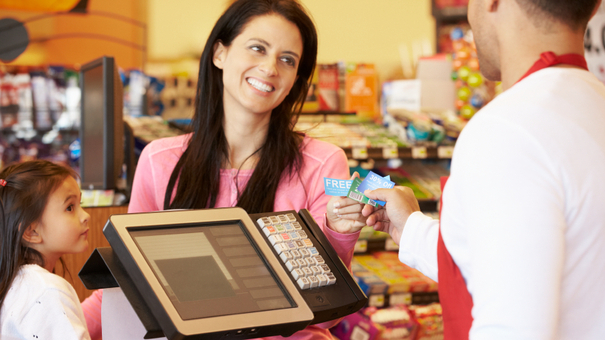 woman-at-checkout-cropped-iStock_000022398219Small